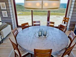 Chilmark house photo - Dining Table For 10 Has Custom Concrete & Metal Top - Glass Doors Open To Both Water-Facing Patio & Front Patio For Outdoor Dining & Entertaining