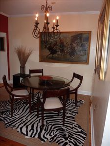 Dining room with antique table and painting