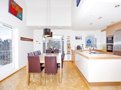 Kitchen with dining table for up to 14