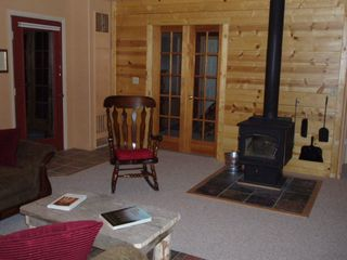 Evergreen house photo - Cozy Colorado feel. Wood-Stove & Comfy Rocker for those Cool Mountain Evenings