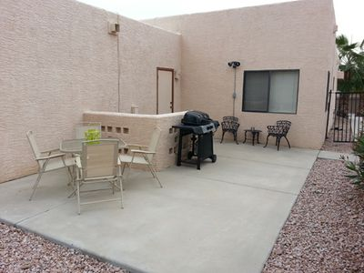 Large backyard includes bbq and picnic table