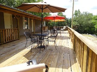 Very Large deck. Great for Grillin'. The Charcoal Grill not shown - Gulfport house vacation rental photo