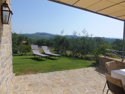 View from terrace to hilltop medieval towns, vineyards and olive groves