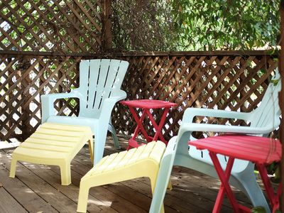 Adirondack chairs on the Star Jasmine covered front deck