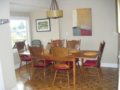 Large open dining room with table and chairs that will accomodate up to 10.