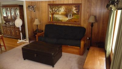 Living room with futon and ottoman twin pull out
