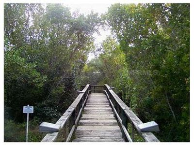 Entrance to boardwalk nature trail near waterfront available to residents only.