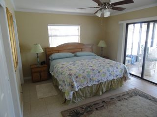 Hernando Beach house photo - The master BR has a premium king bed and look over the pool, lanai and canal.