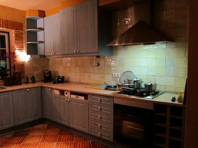 Homey kitchen with beautiful handmade tiles (evening photo)