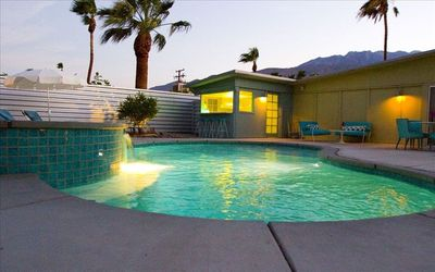 Heated salt water pool/jacuzzi spa with sunning ledges and mountain view!