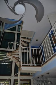 Spiral staircase leads to second and third floor lofts