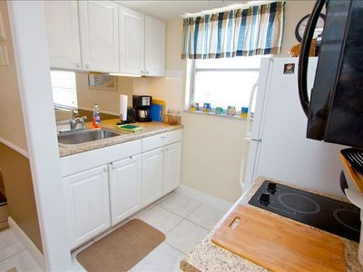 Full Kitchen with 2 burner stove, microwave, coffee maker, toaster