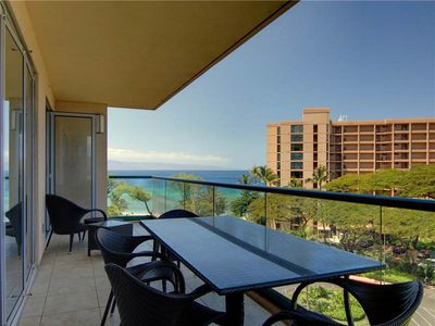 This wonderful lanai has a view of the ocean and greenway.