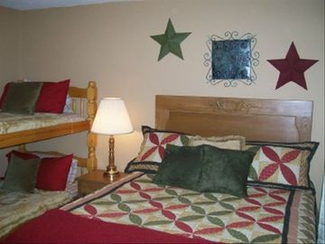 Lodge second bedroom with queen bed and bunks