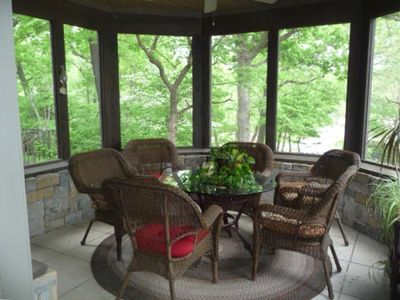 Screened in porch off the kitchen and dining room.