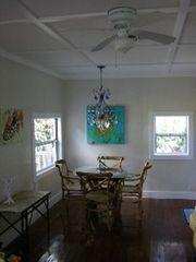 Englewood cottage photo - View of Dining Room with original Heart Pine floors