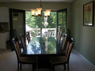 Long Pond house photo - Dinning room table with a walk out to the deck for summer grilling.