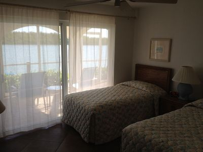 Downstairs bedrooms with twin beds and water views