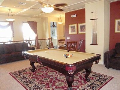 Games room, pool table and card table. Access to balcony overlooking pool.
