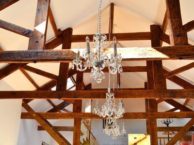 Chandaliers and original beams in The Threshing Barn