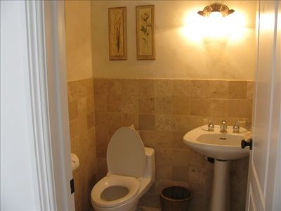 Half Bathroom off Dining Room. All bathrooms feature beautiful tile and granite!