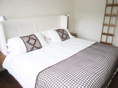 Master Bedroom with white linen wrap headboard. Ample closet space & safety box