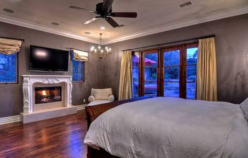King size bed with french doors to pool and spa