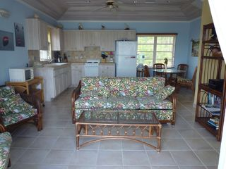 North Palmetto Point villa photo - The Great Room/Kitchen/Dining area of the Cottage at Conch'd Out.
