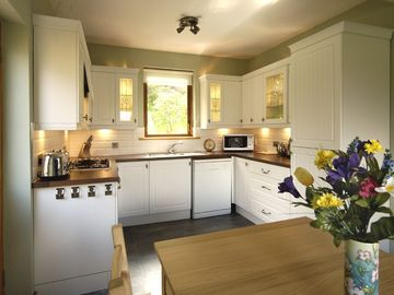 The spacious kitchen dining room has lovely views