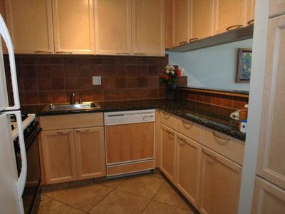 Tile floors and backsplash, slab granite counters and solid maple cabinetry!