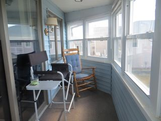 Point Judith house photo - Sit on the enclosed porch and enjoy the panoramic view of the ocean.
