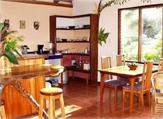 The kitchen and dining area. Watch the hummingbirds in the garden while you eat.
