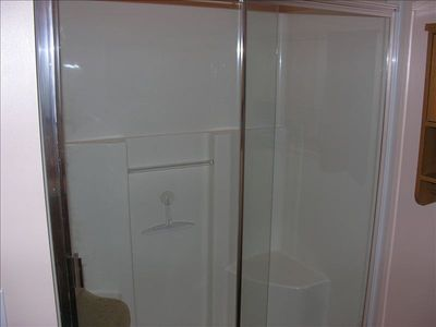 Large shower in bathroom. Has built in seat benche