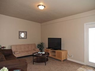 Salt Lake City house photo - FAMILY ROOM #2 OFF DINING AREA (COUCHES, HDTV) DOOR TO BBALL PLAY AREA