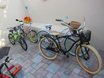 2 adult bike cruiser, 2 childrens bikes, 2 types of scooters & rikpstik