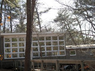 Wellfleet house photo - View of windows on north side with entry ramp