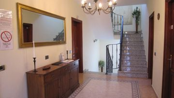 Entrance Hall, leading to first floor, with marble staircase.