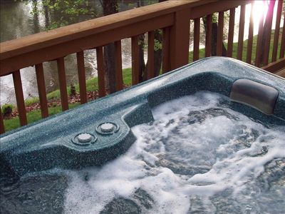 Hot tub on private deck overlooking river
