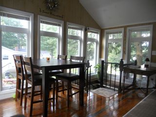 Sebago Lake Basin cottage photo - Dinning area also has wall mounted tv and LL Bean Futon couch in the living area