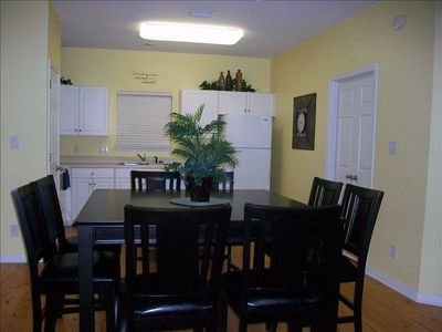 Dining table has seating for 8 with a great view to the living room.