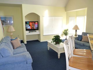 Runaway Beach Resort condo photo - Large living room open to kitchen and dining. 2 sofas and large flat-screen TV.