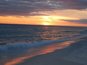 Sunsets on Destin Beach at the Pelican Beach Resort, are amazing.