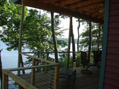 Views from covered main level wrap-around deck showcase Stone Lake's beauty.