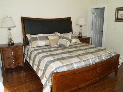 King size master bed with private bathroom,  large closet and tv
