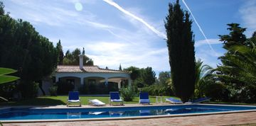 Vale do Covo villa rental - Property view with swimming pool and lawn