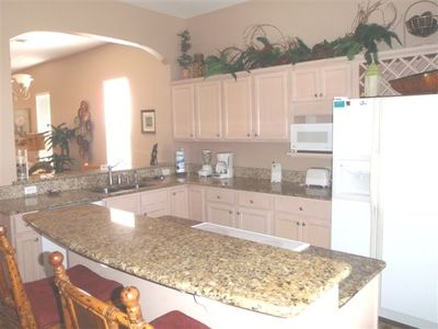 Kitchen granite countertops and island fully stocked!
