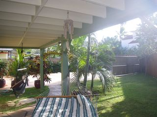 Sunset Beach house photo - hammock and hanging chairs under deck next to BBQ and garden