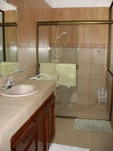 Orchid Room Suite: Full bathroom with hot shower.