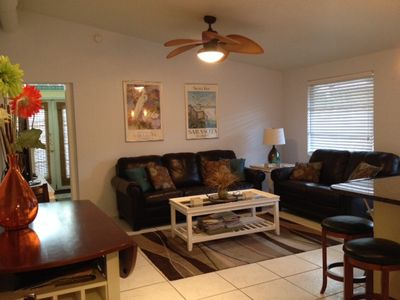 Spacious open concept living area with all new furnishings and vaulted ceilings.