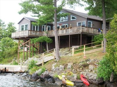 View of home from the river with dock, easy kayak entrance and stairway